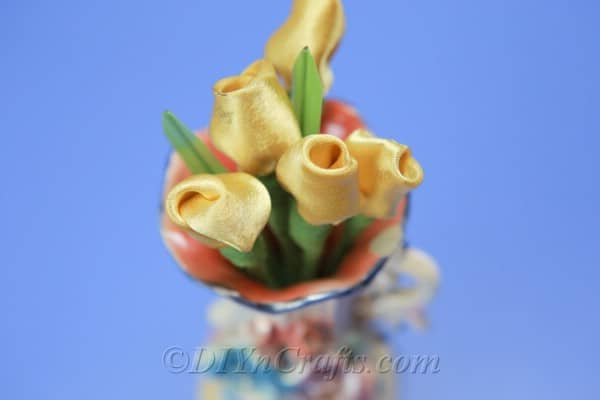 Yellow satin tulips in a vase