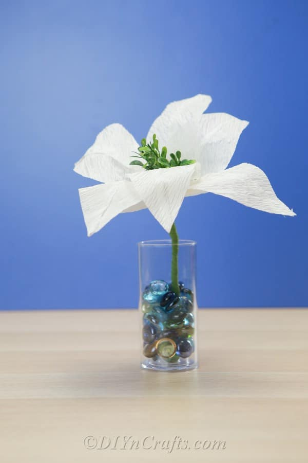 Tissue paper flower in a jar with marbles