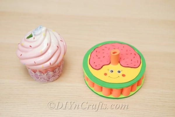 Donut box beside a cupcake