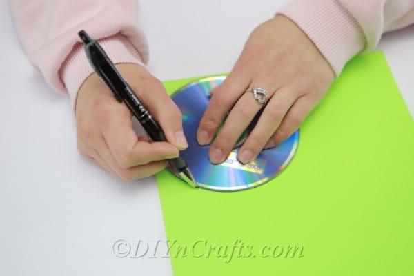 Drawing circles around a CD onto craft foam