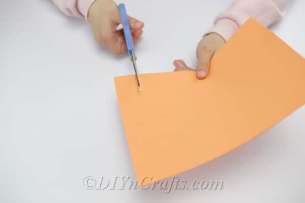 Cutting strips from a sheet of foam