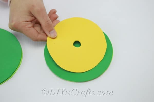 Yellow circle cut from craft foam with a hole in the center