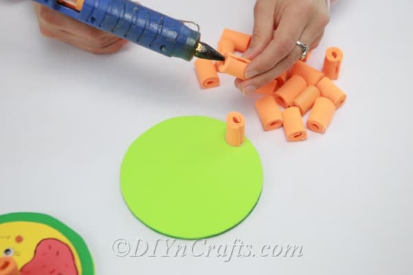 Gluing rolled up strips onto CD base