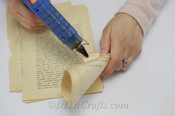 Gluing down ends of book page cones