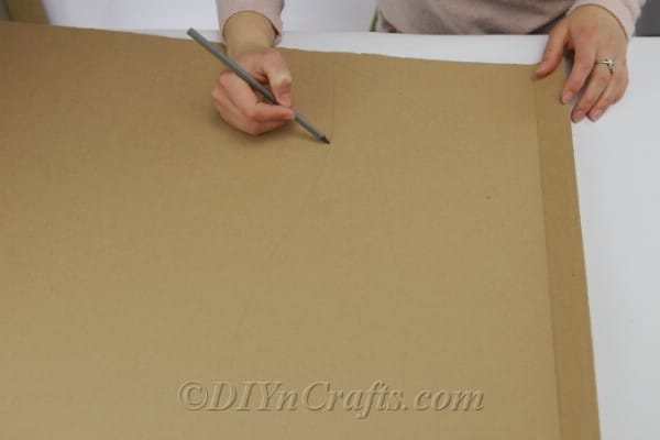Tracing a shape onto a piece of cardboard