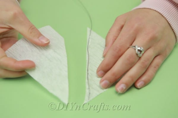 Gluing tissue paper onto floral wire