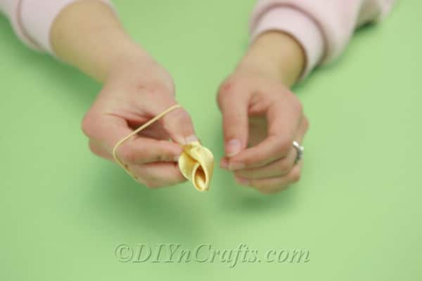 Making a tulip shape from yellow satin