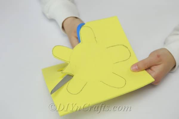 Cutting out the turtle from the craft foam