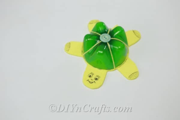 Finished soda bottle turtle in green and yellow