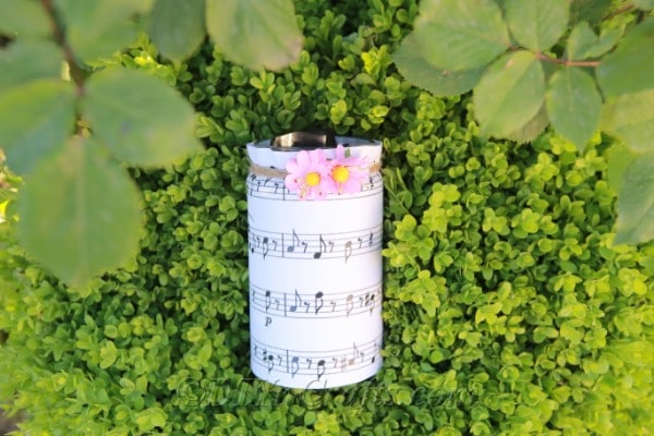 Jar with sheet music in grass