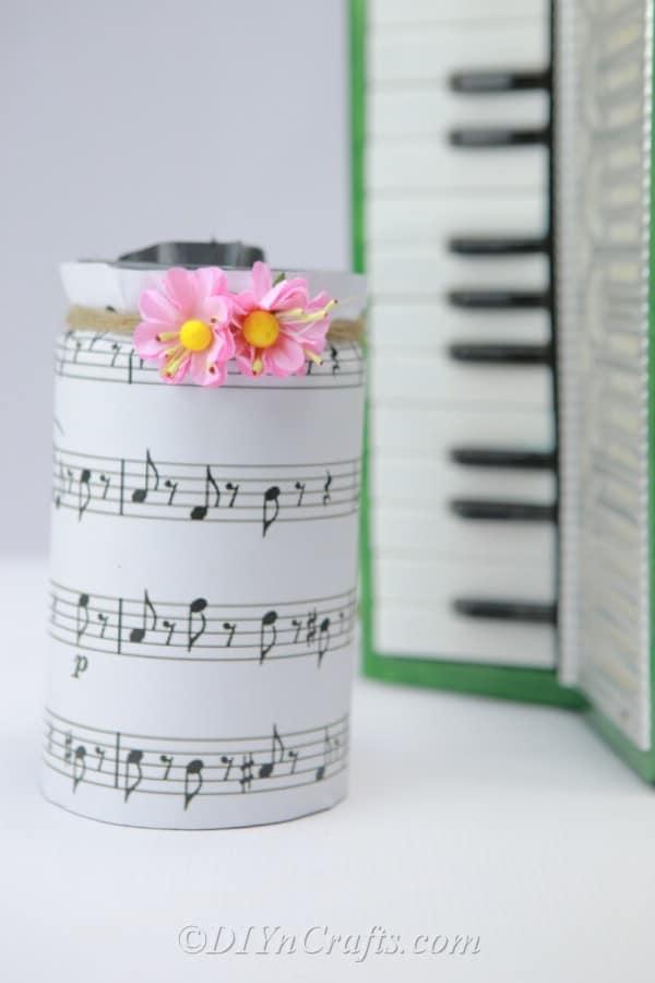 Music sheet jar beside piano