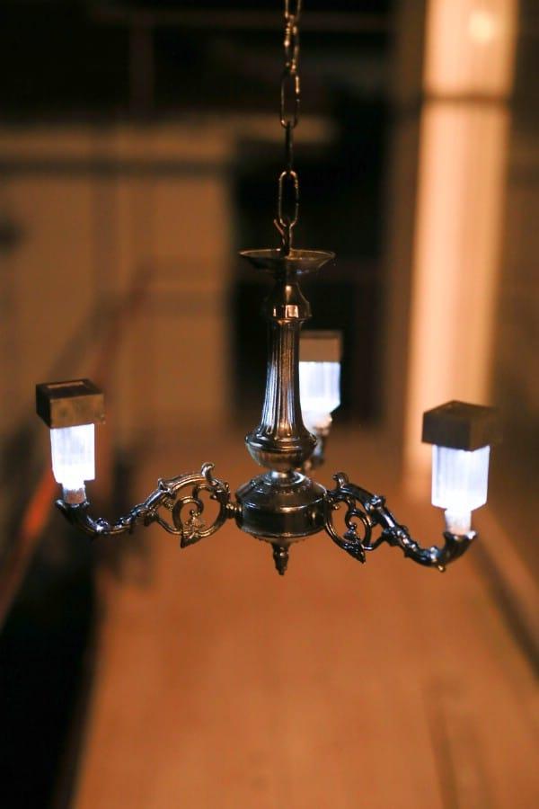 Lit up black solar chandelier