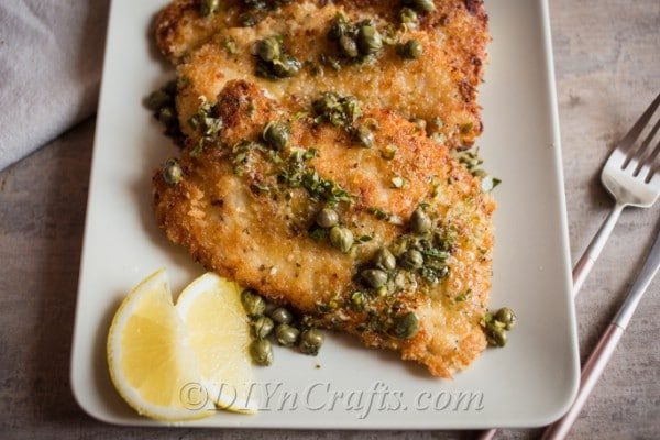 Chicken piccata dish with lemon slices