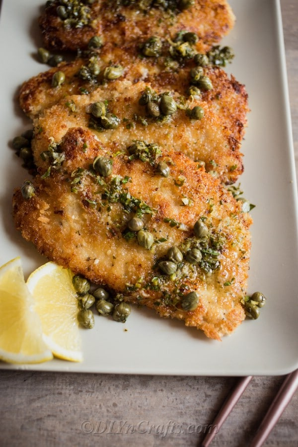 Chicken piccata dish with parsley on top