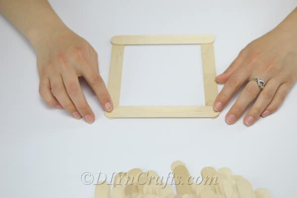 Create a square from craft sticks.