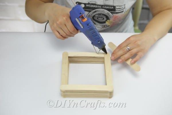 Keep stacking craft sticks.
