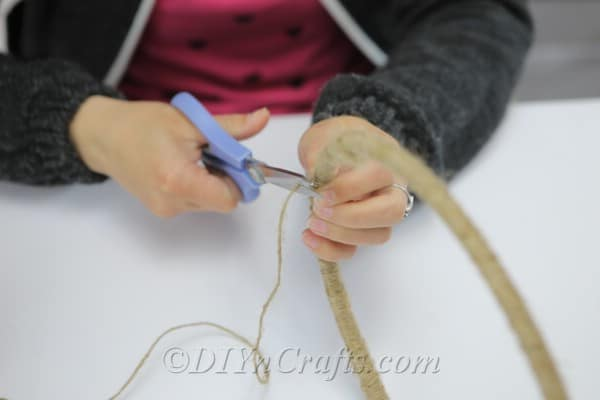 Use a pair of scissors to cut the end of the twine.