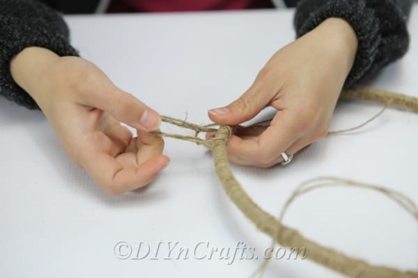 Tie pieces of twine to your hoop.