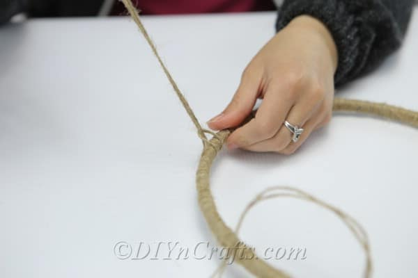 Continue tying pieces of twine to your hoop.
