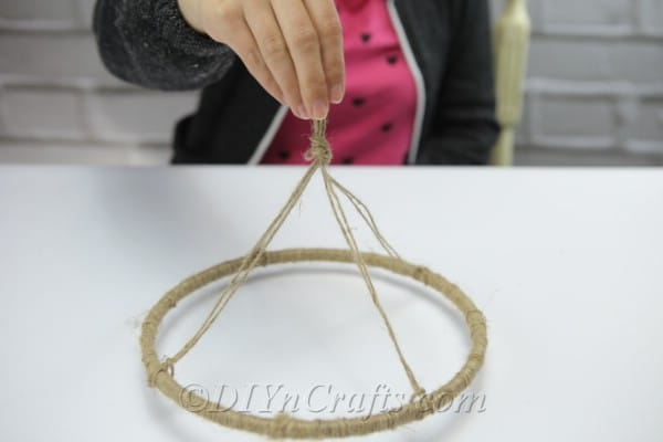 You are now able to hang up your DIY wind chimes once they are completed.