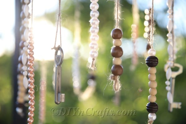 You can make wind chimes out of cheap and simple materials.