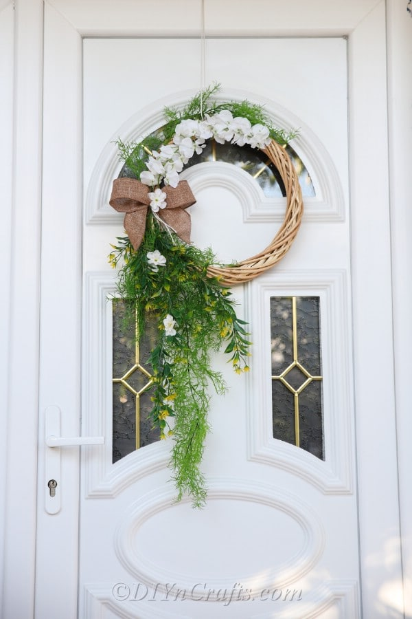 The wreath looks beautiful hanging on the door.