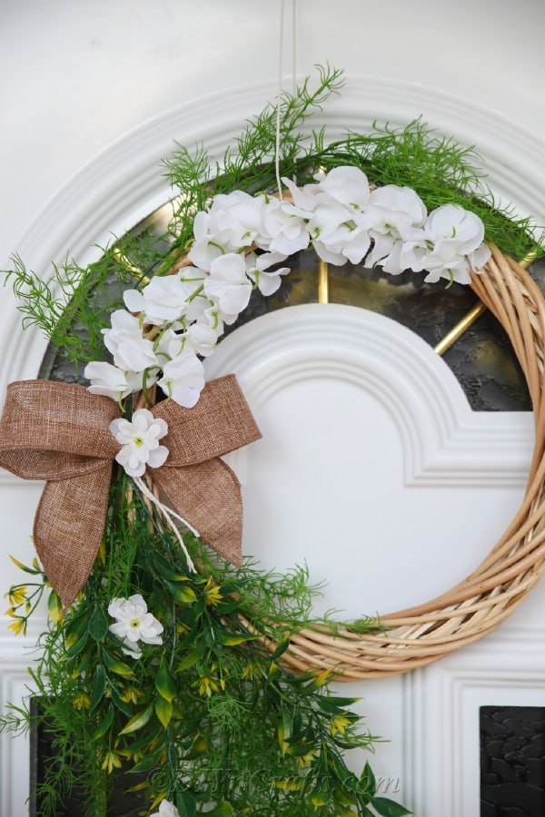 With a DIY wreath, this door looks gorgeous.