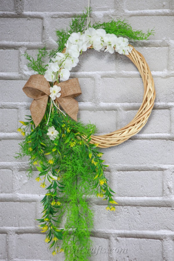 Cheap, simple supplies can be used to create a DIY door wreath.