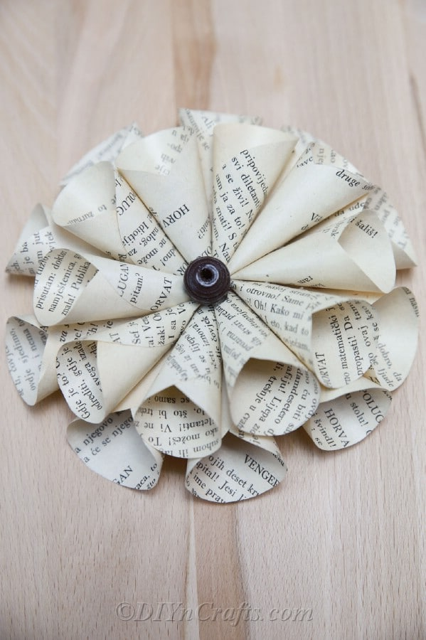 You'll discover that making paper flowers out of old books is simple.