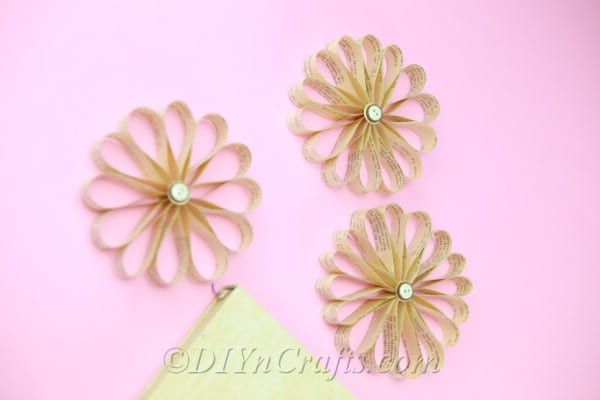 You can make a whole batch of vintage paper flowers once you learn the steps.