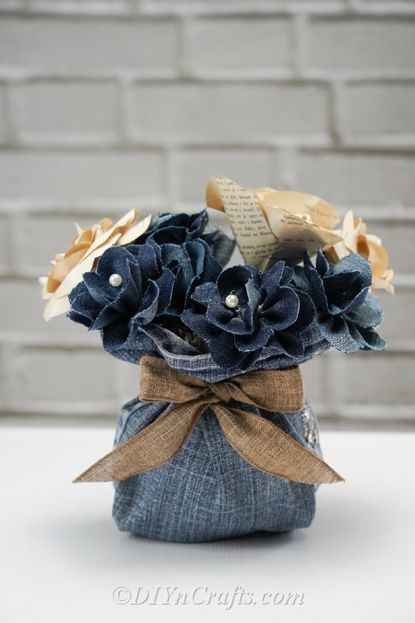 You can create many flowers out of strips of denim for your arrangement