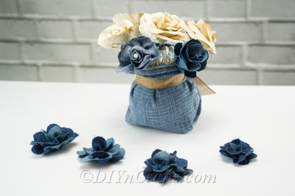 Denim flowers make a rustic centerpiece.