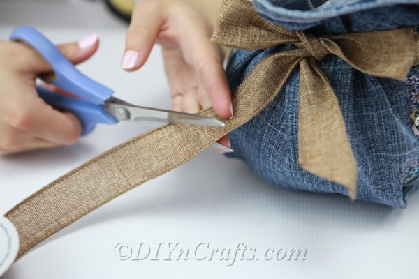 Cut the ends of the ribbon after you have tied it into a bow.