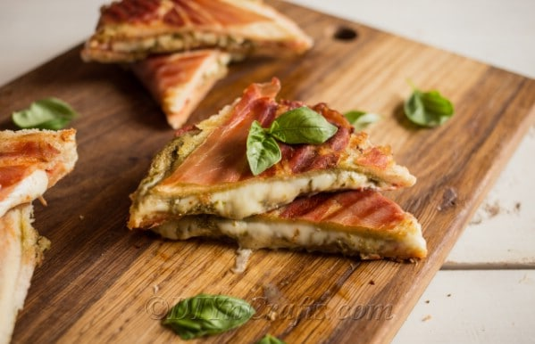 Pesto grilled cheese with prosciutto on top
