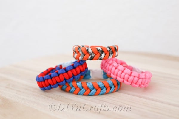 Four paracord bracelets in multiple colors stacked on each other