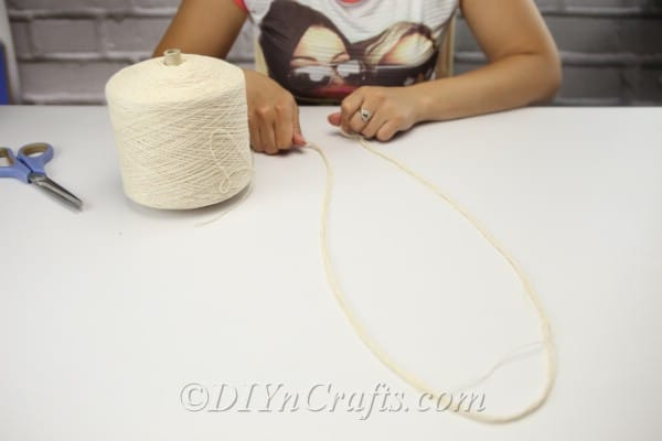 Gather all the lengths of string you will need for the project.