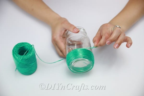 Continue wrapping the string around the jar.