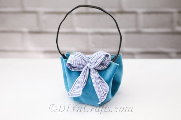 A DIY handbag with a wall in the backdrop.