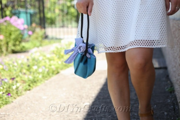 A woman walking with a DIY handbag.