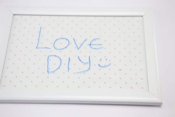 "A decorative whiteboard reads, ""Love DIY :)"""