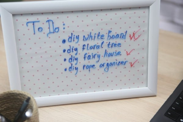 Tasks are listed on a DIY whiteboard.