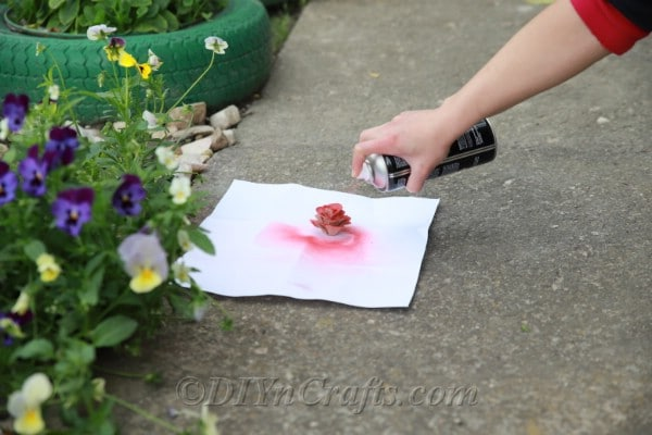 Spray paint your rose any color you like.