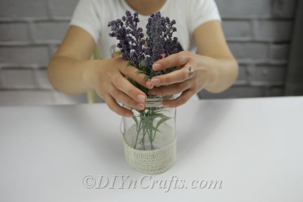 Put the flowers inside the jar.