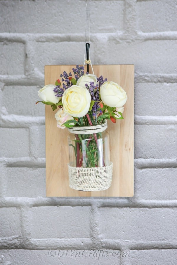 Beautified wall with DIY rustic wall vase.