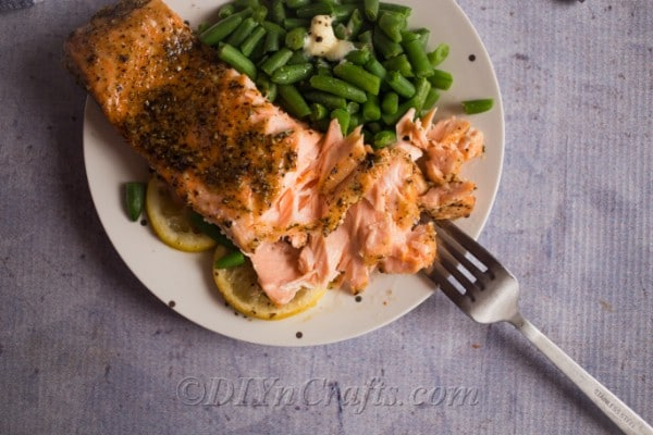 Best baked salmon on a plate with green beans