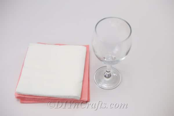 Supplies needed when learning how to fold napkins into a flower
