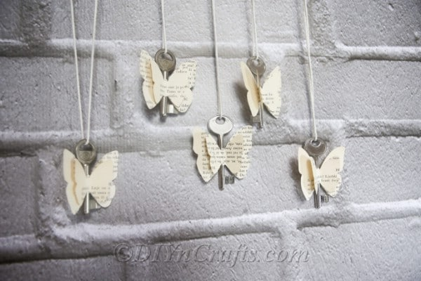 Rustic old book butterflies are lovely displayed against a wall.