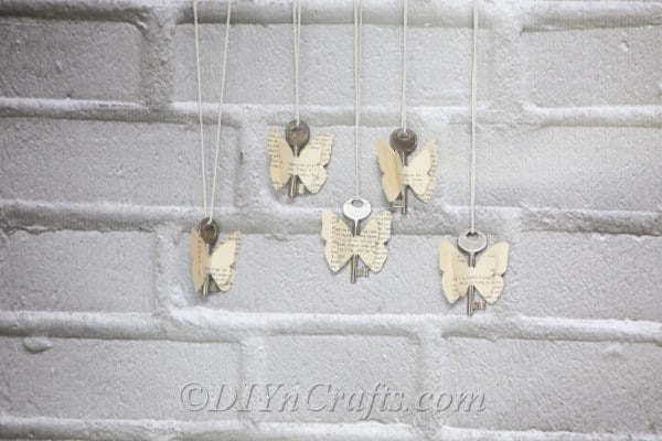 Old book butterflies are displayed against a wall.