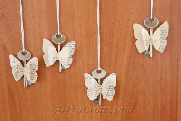 Old book butterflies spruce up a wooden cabinet.