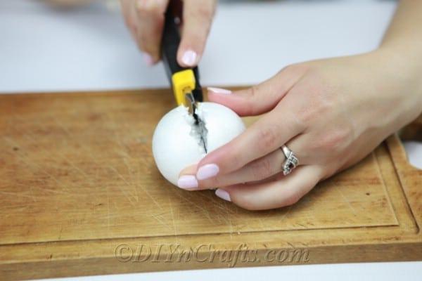 Slice one of the Styrofoam balls in half.